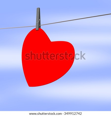 Heart hanging on the clothesline - stock photo