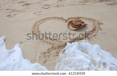 heart hat on the sand are wash off - stock photo
