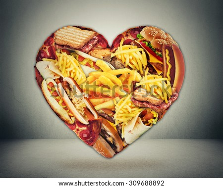 Heart health and bad diet stroke risk concept. Heart shaped of fast junk fatty food  - stock photo