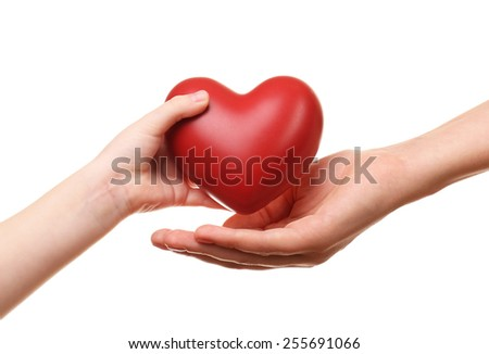 Heart in child and mother hands isolated on white - stock photo