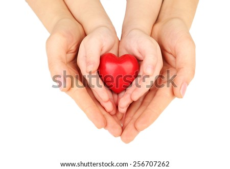 Heart in child and mother hands isolated on white