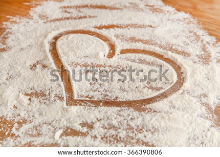 High Quality Heart In Flour On Kitchentop In The Kitchen.