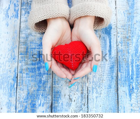 heart in hand romantic vintage background - stock photo