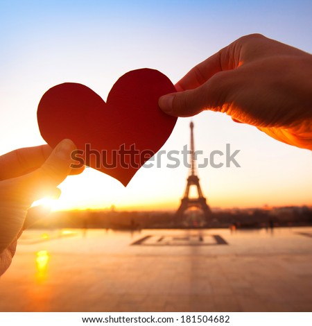 heart in hands, loving couple in Paris, France - stock photo