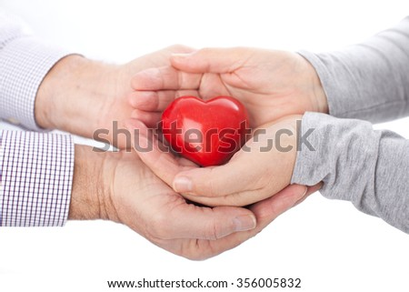 Heart in hands on white background