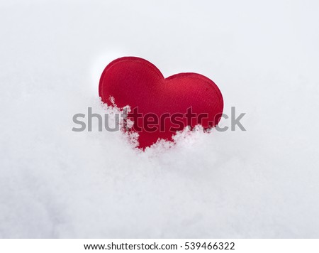 Heart in snow. Congratulation on St. Valentine's Day. Greeting card. Romantic background
