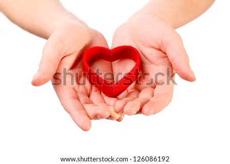 Heart in the hands isolated on white
