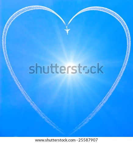 Heart in the sky drawn by jet and sun in the middle - stock photo