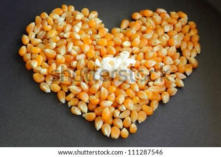 Heart kernels and popcorn - stock photo