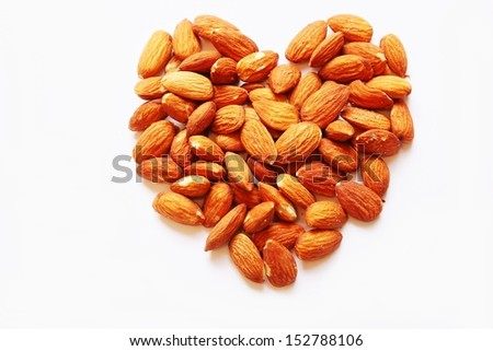 Heart made from almonds on white background   - stock photo
