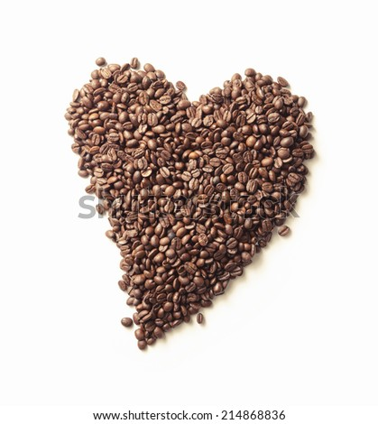 Heart made from coffee beans isolated on white background
