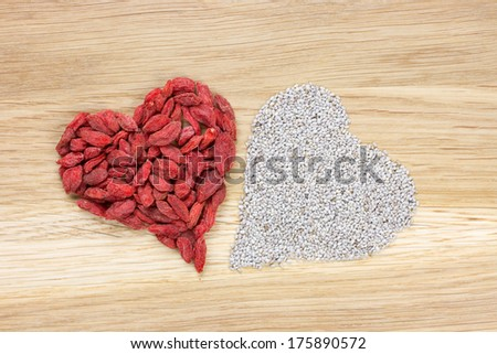 heart made of dried goji berries and white chia seeds - stock photo