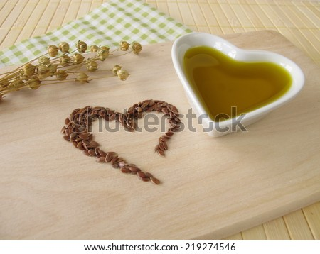 Heart made of linseed and flaxseed oil - stock photo