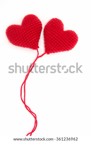 Heart made of red yarn on white background for lovers