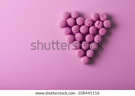 heart made of small candies - stock photo