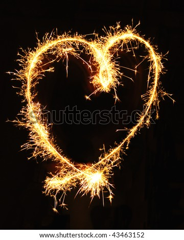 Heart made of sparklers isolated