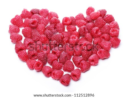 Heart made out of raspberries over white background - stock photo