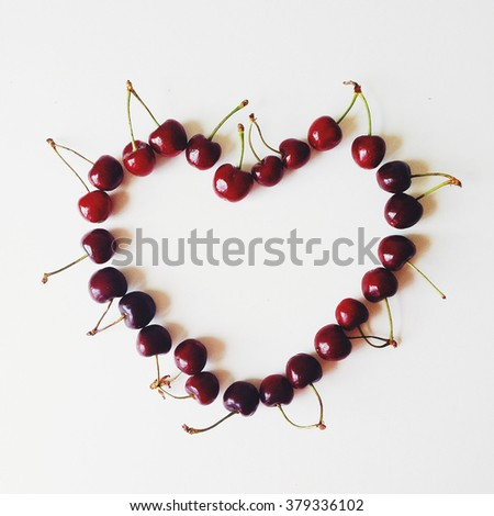 Heart made with cherry. Flat lay, top view - stock photo