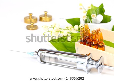 Heart medicine from lily of the valley - stock photo
