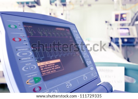 Heart monitor in a hospital room.