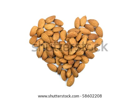 Heart of almonds isolated on white background - stock photo