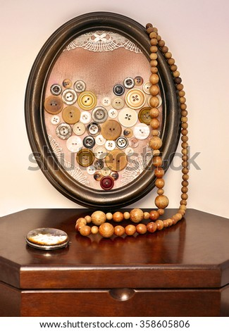 Heart of brown buttons in a vintage frame