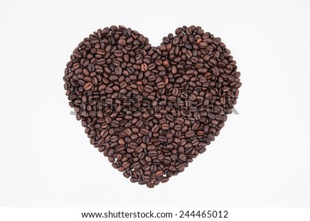 heart of coffee bean on white background - stock photo