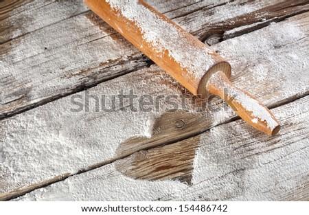 heart of flour on wooden desk  - stock photo