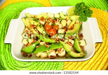 Heart of palm and avocado salad with cherry tomatoes - stock photo