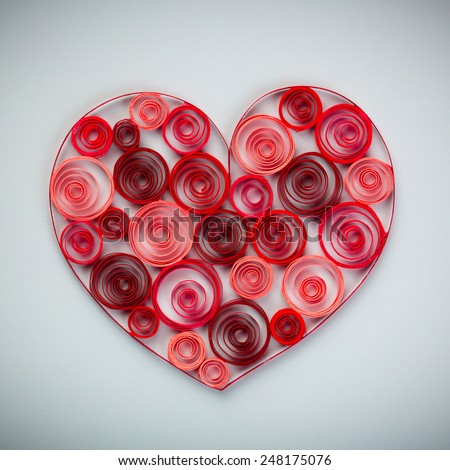 Heart of paper quilling on gray background - stock photo
