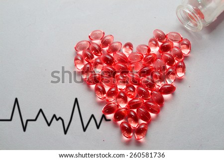 heart of pills. Medical background or texture. Medical bottle and pills - stock photo