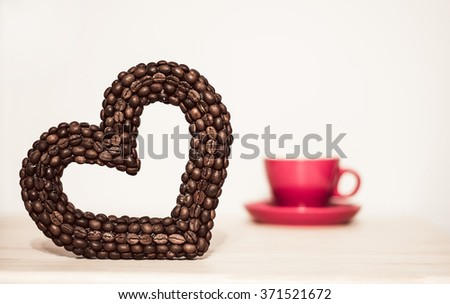 Heart of the coffee beans and red or pink cup. Valentine's Day. Be my Valentine. Theme of love, romance, coffee time, cafe. - stock photo