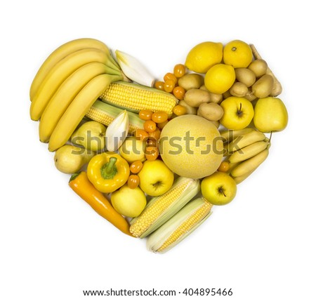 Heart of yellow fruits and vegetables isolated on a white background - stock photo