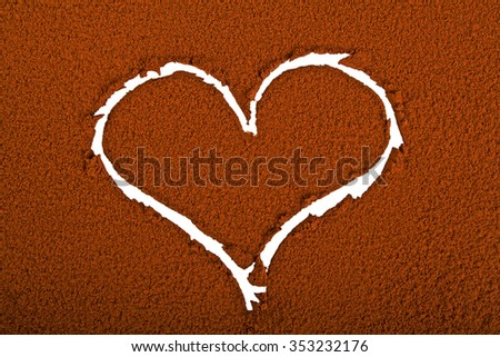Heart on a background of cocoa powder - stock photo