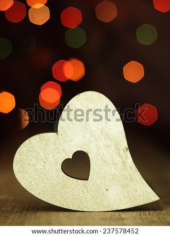 Heart on a wooden boards background.