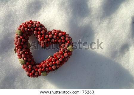 heart on background of snow (please check my portfolio for another image with the heart in the lower right corner) - stock photo