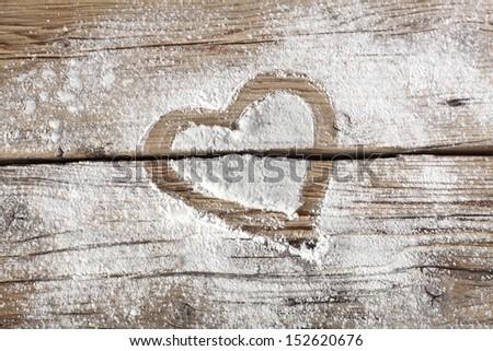 heart on desk and flour  - stock photo