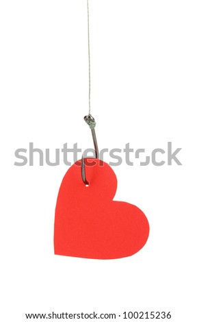 Heart on fish hook isolated on white - stock photo