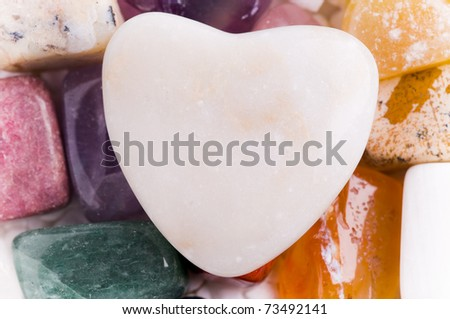 heart on many different natural stones in beautiful colors - stock photo