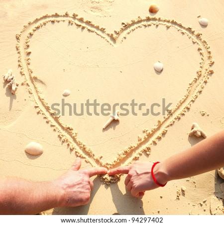 Heart on the beach - stock photo