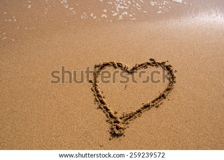 Heart on the sand beach.