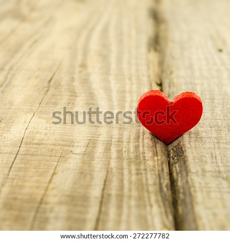 Heart on wooden table - stock photo