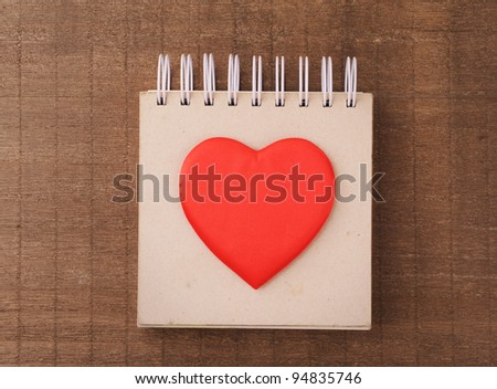 heart painted in the notebook - stock photo