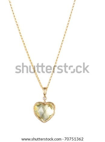 heart pendant of gold, diamond and lemon quartz - stock photo