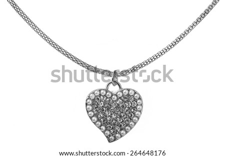 Heart pendant shape on chain, made from silver and gem stones and crystal