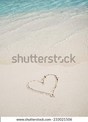 Heart picture draw on the white sand beach - stock photo