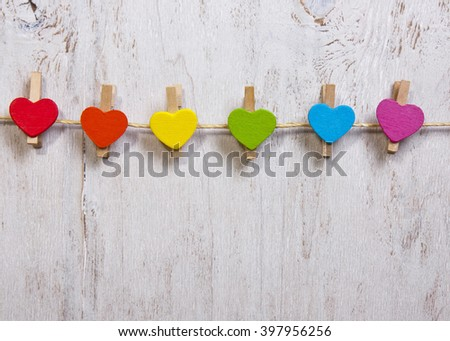 heart rainbow of colors on a white wooden background,LGBT symbol - stock photo