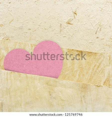 heart recycled paper stick on paper background - stock photo