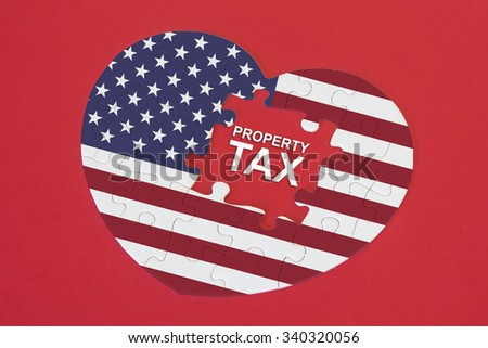 Heart shape America Flag jigsaw puzzle with a written word Property Tax with red background