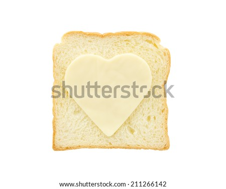 Heart shape cheese on bread isolated